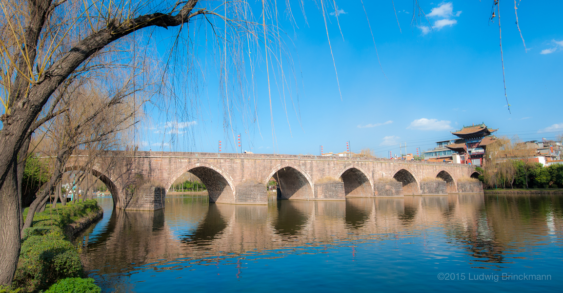 Picture: The main crossing of the Luyi River 禄衣河, one of the lowest points on the Kunming-Dali road, gave rise to what is today Lufeng Town. The Xingsu Bridge 星宿桥, build during the late Qing, still stands today, void of traffic in a park in Lufeng.