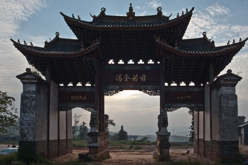 Picture: Shengjingguan 胜境关 is the old border crossing from Yunnan to Guizhou near Fuyuan. The archway with the four stone lions described by many early explorers still stands, as does the (now renovated) stone gate. From here a narrow path leads down into a peaceful valley, presenting the modern-day traveller with views that have changed little since the caravan days.